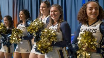 The UC Davis cheer team greets guests